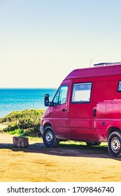 Caravan recreational vehicle on mediterranean coast in Spain. Camping on nature. Vacation and travelling in mobile home.