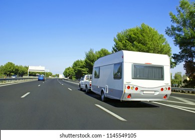 Caravan towed on highway during a departure on vacation