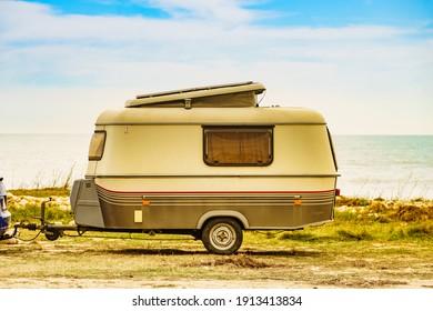 Caravan trailer camping on seashore. Capicorb, Valencia region Spain. Vacation with mobile home.