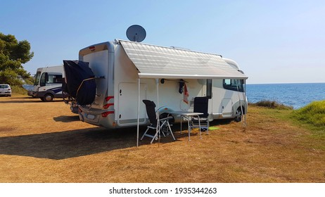 caravan trailer car by the sea in summer holidays sunny hot day