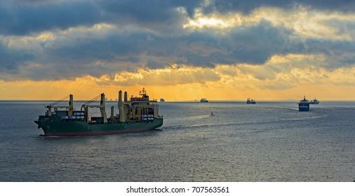 Caravan of various ships queue offshore approaching Shanghai port. Yellow sea, China