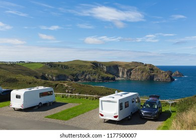 Caravans on a pitch by a beautiful coast scene