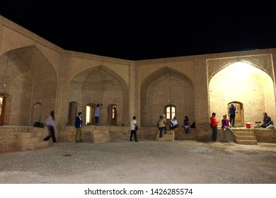 Caravanserai, Kashan, Iran - October 2017 : Tourists are hanging out in front of their units at a caravanserai near Kashan, Iran.