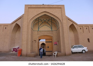 Caravanserai, Kashan, Iran - October 2017 : A female tourist standing in front of a gate to a caravanserai near Kashan, Iran.