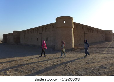 Caravanserai, Kashan, Iran - October 2017 : Tourists walking outside of a caravanserai near Kashan, Iran in the morning.