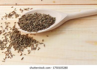 Caraway seeds in wooden spoon. food seasoning. Dry Cumin Seed