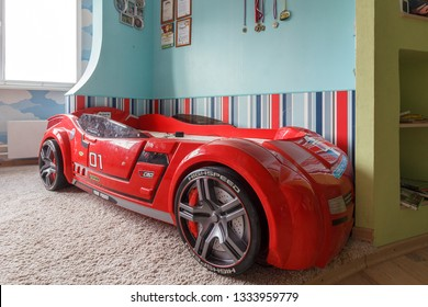 Carbed. Bed machine Cilek BiTurbo, pink red. bed for girl and boy in nursery. children's bed in form of racing car. teenage kids room featuring a real racing car. Children's room interior. Moscow 2019