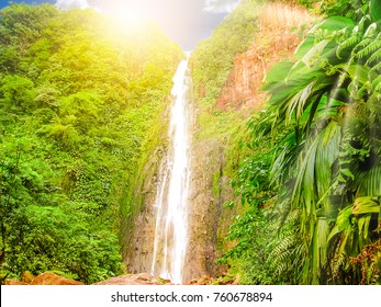 Carbet Falls or Les Chutes du Carbet at sunset, one of three waterfalls in tropical rainforest on Carbet River, Guadeloupe island, French Caribbean. The falls are one of the most popular visitor sites