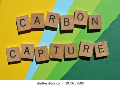 Carbon Capture, words in wooden alphabet letters isolated on green, blue and yellow