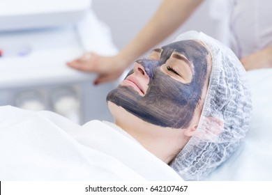 Carbon face peeling procedure. Laser pulses clean skin of the face. Hardware cosmetology treatment. Process of photothermolysis, warming the skin, laser carbon peeling. Facial skin rejuvenation.
