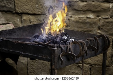 Carbon fire in a forge, detail of a workshop with iron
