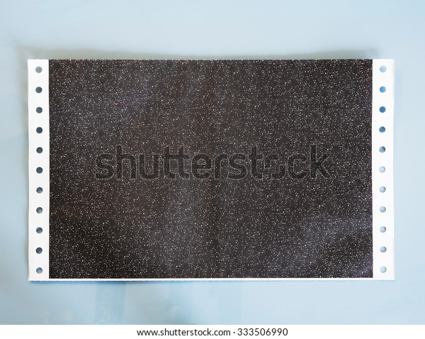 carbon salary slip, or carbon paper on blue background