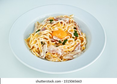 Carbonara pasta with poached egg.