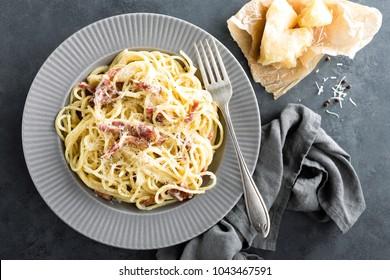 Carbonara pasta, spaghetti with pancetta, egg, hard parmesan cheese and cream sauce. Traditional italian cuisine. Pasta alla carbonara