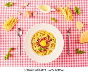 Carbonara pasta, spaghetti with pancetta, egg, hard parmesan cheese, basil and cream sauce. Traditional italian cuisine. Pasta alla carbonara