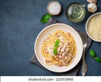 Carbonara pasta. Spaghetti with pancetta, egg, parmesan cheese and cream sauce. Traditional italian cuisine. Top view, copy space.