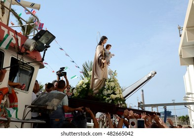CARBONERAS, ALMER�A, SPAIN AUGUST, 15: Unidentified people climbing the Virgin to a fishing boat the day of the feast of the fisherman. On August 15 , 2016 in Carboneras