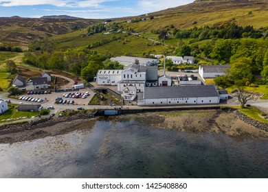 Carbost, Isle of Skye, UK – May 12 2019: Aerial view of the Talisker Distillery, a single malt Scotch whisky distillery, on the west coast of Skye on the shores of Loch Harport in Carbost on the Isle