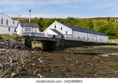 Carbost, Isle of Skye, UK – May 12 2019: Talisker Distillery, a single malt Scotch whisky distillery, on the west coast of Skye by Loch Harport in Carbost on the Isle of Skye, Scotland, UK