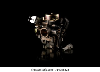 carburetor on a black background