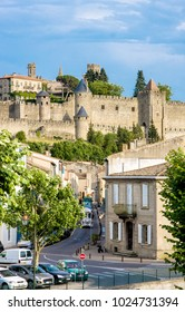 CARCASSON, FRANCE - JULY 7, 2016: Train at strret in Carcassone against medieval fortress, it was added to the UNESCO list of World Heritage Sites in 1997