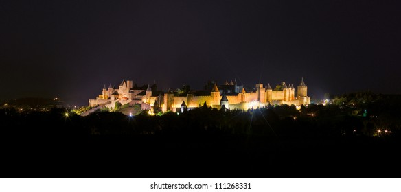 Carcassonne castle at night, view from highway