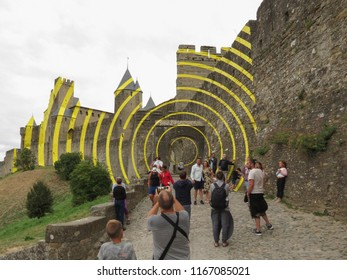 CARCASSONNE, FRANCE - CIRCA AUGUST 2018: yellow circles contemporary art by Felice Varini