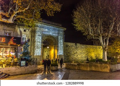 Carcassonne, France - Dez 10th 2017 - Big group of people entering the old town of Carcassonne with dry trees and restaurant
