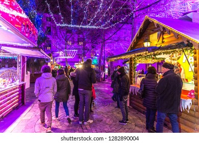 Carcassonne, France - Dez 10th 2017 - Locals and tourists enjoying a christmas market in Carcassonne in a cold night in front of local shop