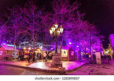 Carcassonne, France - Dez 10th 2017 - People enjoying the colorful christmas market of Carcassonne in France with local store and trees.
