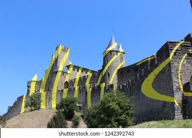 """Carcassonne, France - July 25 2018: Citè de Carcassone with the artwork of Felice Varini """"Concentriques excentriques"""""""