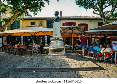 Carcassonne, France - June 14th, 2018: Restaurant terrace in Carcassonne, a hilltop town in southern France, is an UNESCO World Heritage Site