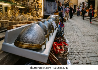 Carcassonne, France - June 14th, 2018: Touristy medieval looking souvenirs at Carcassonne, a hilltop town in France, is an UNESCO World Heritage Site
