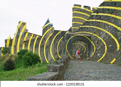 Carcassonne, France - June 15th, 2018: Carcassonne with temporary yellow circles on the outside walls, artwork on the occasion of 20 years Unesco heritage in 2018
