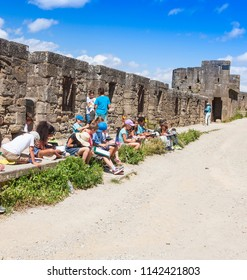 CARCASSONNE, FRANCE - JUNE 2018: Children at a drawing lesson in the fortress of Carcassonne, France