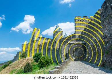 Carcassonne, France - June 29 2018:Designed by Felice Varini,Thin, painted aluminium sheets on the walls and towers,a succession of yellow 'eccentric concentric circles.