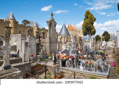 CARCASSONNE, FRANCE: MARCH 29, 2018: The Cemetery of the City in Carcassonne, next to Narbonnaise door in a medieval fortress in the french department of Aude