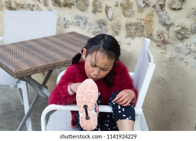 CARCASSONNE, FRANCE - MAY 04, 2018: Unknown girl visiting the French fortified city of Carcassonne, in the department of Aude, region of Occitanie
