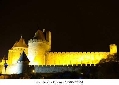 Carcassonne, France - OCTOBER 18, 2017. Night view of the illuminated fortress wall and towers of the Carcassonne castle