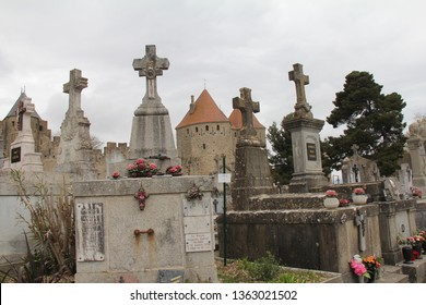 CARCASSONNE, FRANCE-APRIL 2, 2019:  The cemetery of the medieval city of Carcassonne sits just outside the gates to to the ancient city.