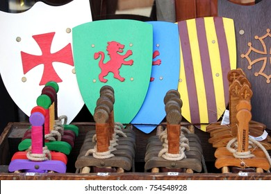 Carcassonne, Languedoc-Roussillon, France - August 24 2017: Toy wooden swords and shields for sale in a toyshop in Carcassonne, for children to play medieval battles