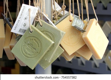 "Carcassonne, Languedoc-Roussillon, France - August 24 2017: Specialist French soap made by ""Savon de Marseille"" hanging on a rack for sale in a perfumery"
