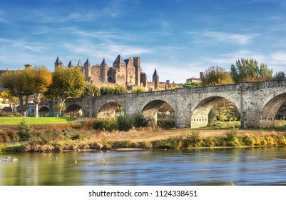 Carcassonne and the Le Pont Vieux bridge viewed from across the Aude river.  Southern France