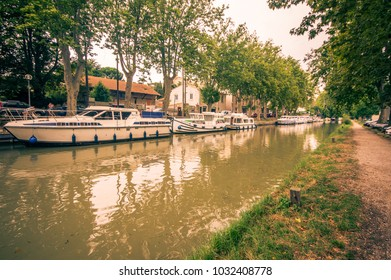 CARCASSONNE,FRANCE - JULY  25: boats anchored at the famous Canal du Midi  on July 25, 2014 in Carcassonne, France. The Canal is a 241 km (150 mi) long canal in Southern France.