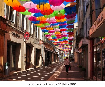 CARCASSONNE/FRANCE - September 11, 2018. Colourful umbrellas cover a shopping street in Carcassonne, Aude, Occitanie, France