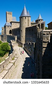 Carcassonne,France-08 20 2015:people enjoying the visit of the fortified city of Carcassonne,restored in 1853 by architect Viollet-le-Duc,and added to the UNESCO list of World Heritage Sites in 1997.