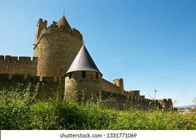 Carcassonne,France-08 20 2015:The wall and towers of the fortified city of Carcassonne, restored in 1853 by architect Viollet-le-Duc,and added to the UNESCO list of World Heritage Sites in 1997.
