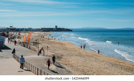 Carcavelos, Portugal - June 10, 2019: High perspective view of people at Carcavelos beach, near Lisbon, Portugal