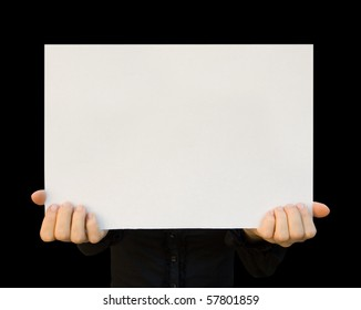 a card blank in a hand on the black