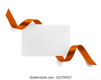 Card with festive ribbon on white background
